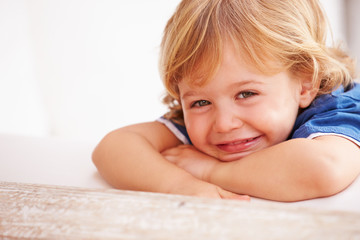 Portrait Of Smiling Young Boy Playing Outside