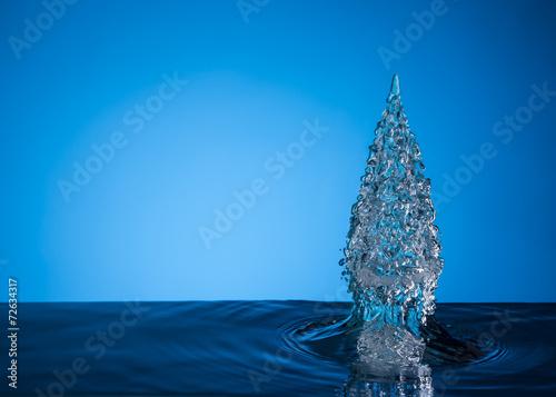 christmas tree on blue background - 72634317
