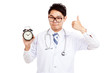 Asian male doctor show thumbs up with a clock