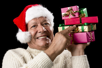 Male Senior Firmly Pointing At Six Wrapped Gifts