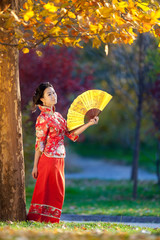Portrait of a beautiful young asian woman with fan
