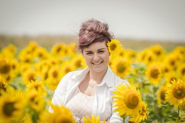 Beautiful woman  in sunflower field