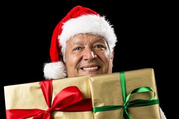 Smiling Aged Man Peeking Across Two Golden Gifts