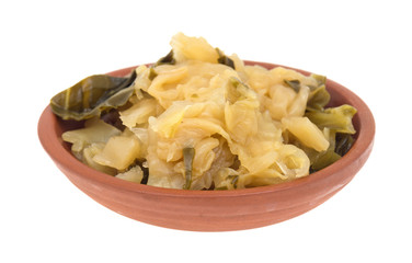 Cooked cabbage in a small bowl