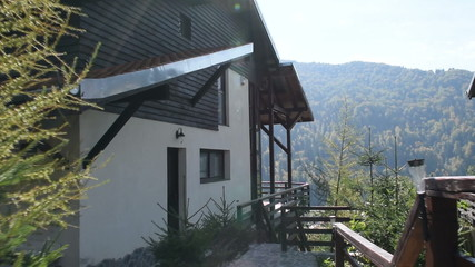 Steadycam shot of a new modern mountain cabin