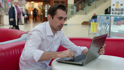 Man at work with a laptop trying to avoid the problem
