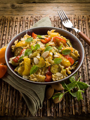 pasta with capsicum zucchinis and sliced almond