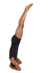 muscular black man doing upside down yoga on white background