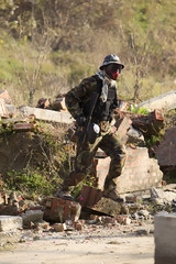 Paintball player in running position