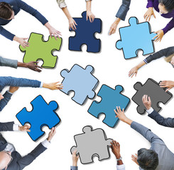 Group of People Holding Jigsaw Photo Illustration