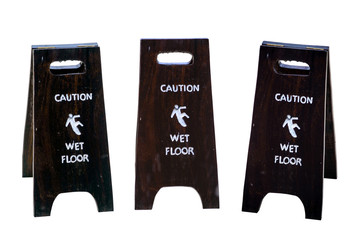 Sign warning of caution wet floor isolated on white