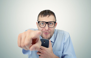 Funny businessman in glasses pointing at you