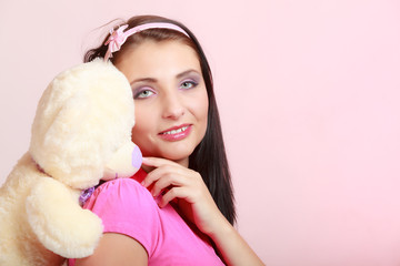 Childish young woman infantile girl in pink