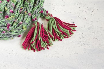 warm winter scarf with funny colored pompoms