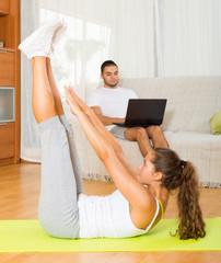 female training on mat and inert guy resting