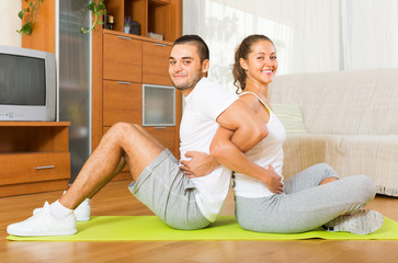 couple doing  exercises together at home