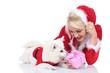 Niedlicher Spitz mit Weihnachtsfrau