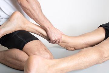 Massage of a male calf muscle