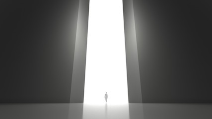 A lonely person walking through a gate