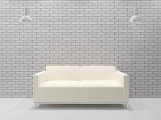 Sofa vor Ziegelwand