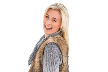 Blonde in winter clothes smiling