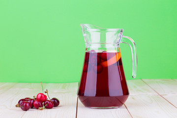 Pitcher with cherries and juice