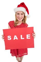 Pretty blonde in santa hat holding a red sale poster
