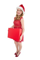 Smiling woman in santa hat holding box