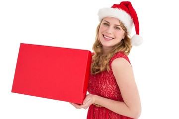 Pretty blonde in red dress holding a box