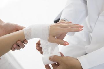 Doctors bandage to women of wrist