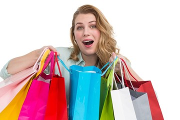 Overwhelmed young woman with shopping bags