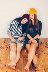Girl friends resting after a party a party