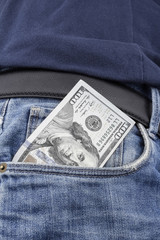 US Dollar note in the front pocket.
