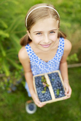 Blueberries - girl with picked blueberries