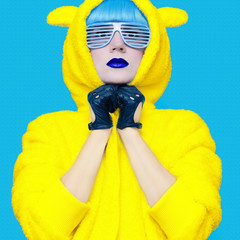 Teddy bear crazy girl in a bright hoodie on a blue background co