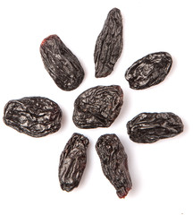 Black raisin over white background