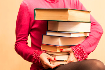 A large number of books in the hands of women