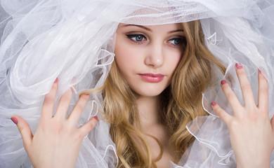 Fashion photo of beautiful women under white veil.