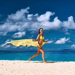 Woman with sarong at beach