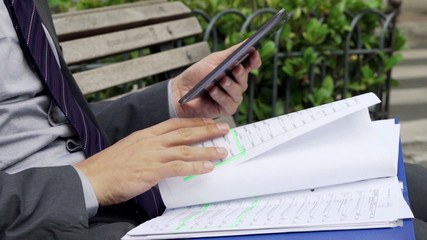Businessman hands comparing data on tablet computer