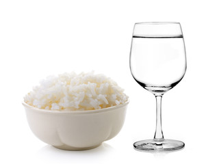 Rice in a bowl and Glass of water on a white background