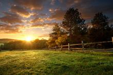 "Постер, картина, фотообои ""Picturesque landscape, fenced ranch at sunrise"""