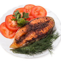 Slice of baked trout with vegetables