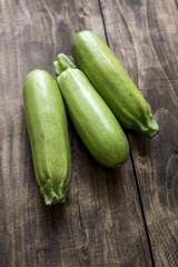 Fresh zucchin on a old wooden board
