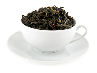 black leaves tea in cup