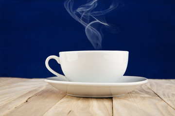 cup of coffee on a dark blue background