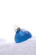 canvas print picture - Blue Christmas bauble with snow