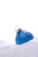 Blue Christmas bauble with snow