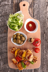 grilled meat and vegetables on board