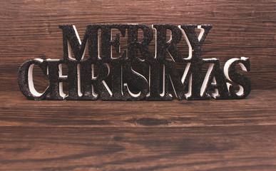 Merry Christmas vor Holzhintergrund